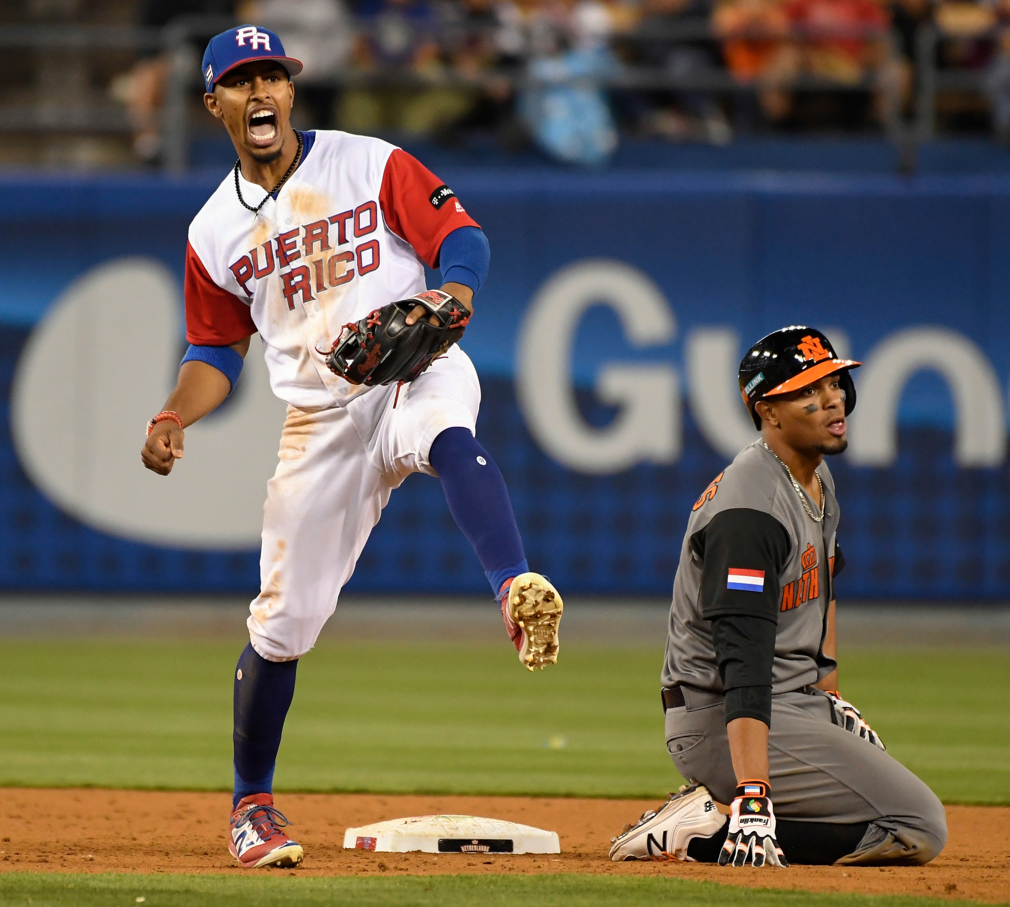 8cff9629c4f ... Francisco Lindor (12) celebrates after forcing out Netherlands  infielder Xander Bogaerts (1) to start a double play during the 2017 World  Baseball ...